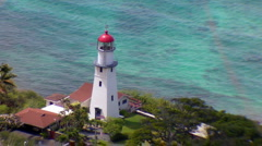A Lighthouse Overlooks the Shallow Waters Stock Footage