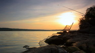 Timelapse fishing at sunset. Shot with slider. Stock Footage