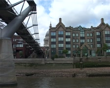 Passing Millenium Bridge and St Pauls on Gloomy Day, London England GFSD Stock Footage