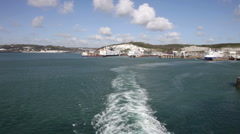 Car ferry leaving the harbour at Dover, Kent, UK Stock Footage
