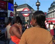 Women waiting at Underground Entrance, London England GFSD Stock Footage