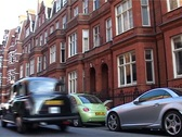 Stock Video Footage of London Street Scene with Black Cab, London England GFSD