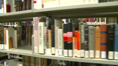 Dolly shot, library  bookshelves Stock Footage