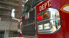 Fire truck at scene low angle tight pan Stock Footage
