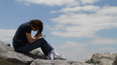 Praying On Rocks Stock Footage