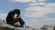 Stock Video Footage of Praying On Rocks