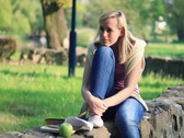 Young attractive happy smiling woman in the park, dolly shot NTSC Stock Footage