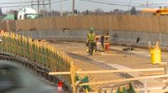 Construction worker on bridge overpass Stock Footage