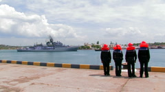 Mooring team awaits the arrival of a warship. Stock Footage