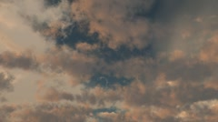 Rosy clouds at dawn or dusk Stock Footage