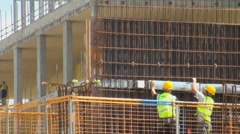 Construction Workers with Hi Viz Jackets and Safety Helmets Stock Footage