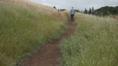 Older man on hiking trail Stock Footage