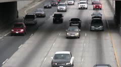 Slow moving vehicles on freeway Stock Footage