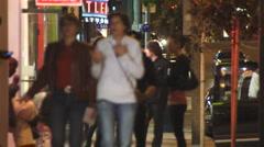 PEOPLE ON SIDEWALK AT NIGHT - stock footage