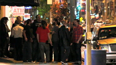 PEOPLE ON STREET AT NIGHT Stock Footage