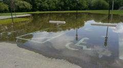 Flooded parking lot. Handicap spots. Stock Footage