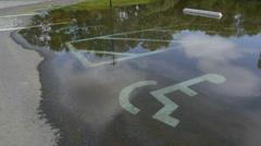 Flooded parking lot. Handicap spots. Close up. Stock Footage