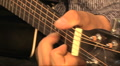 musician playing guitar, close-up Footage