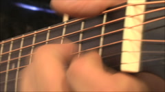 Musician playing guitar, close-up Stock Footage