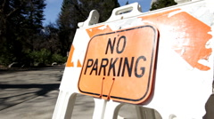 No parking sign on side of road Stock Footage