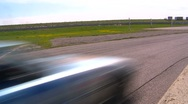 Stock Video Footage of motorsports, Chumpcar race, #7 wide shot corner reverse angle