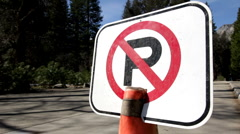 No parking sign on cone by road Stock Footage