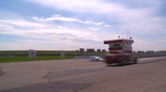 motorsports, Chumpcar race, #11 through frame with tower - stock footage