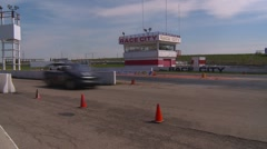 motorsports, Chumpcar race, #14 through frame with tower - stock footage