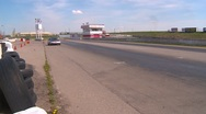 Stock Video Footage of motorsports, Chumpcar race, #18 entering front straight with tower