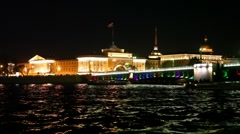 Bridge, Winter Palace and Admiralty standing on embankment Neva River at night Stock Footage
