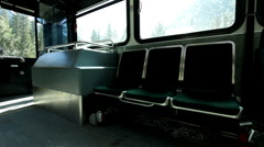Bus goes from stop to moving position in woods Stock Footage
