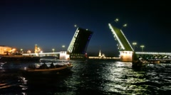 Some boats swim about dissolved palace bridge on Neva Stock Footage