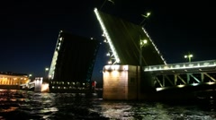 Raised drawbridge night on Neva illuminated Stock Footage