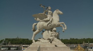 Paris Statue in busy part of city Stock Footage
