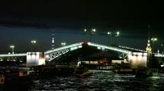 Many boats float near raised shined Palace Bridge Stock Footage
