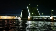 Stock Video Footage of Dry cargo ship floats through raised bridge night on Neva river