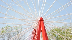 Brightly colored Ferris wheel against the blue sky Stock Footage