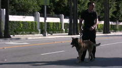 K9 unit checking for bombs before President Obama's arrival Stock Footage