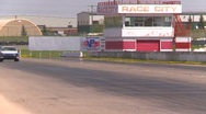 Stock Video Footage of motorsports, Chumpcar race, #38 front straight long shot