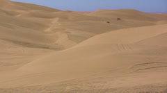 Sand dunes with buggies - stock footage