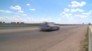 Stock Video Footage of motorsports, Chumpcar race, #45 front straight wide shot reverse