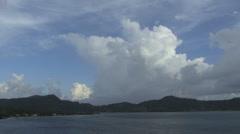 Bora Bora big thunderhead over a motu Stock Footage