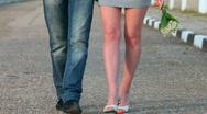Loving couple walking along  road Stock Footage