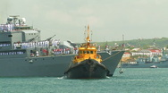 Stock Video Footage of Turkish warship and tug.