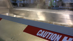 Caution Hot Surface - Hot Food Case Stock Footage