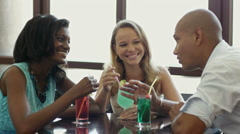 Two women and man having fun in pub Stock Footage