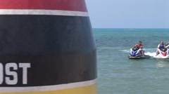 3 Waverunner with people on them at the Southernmost Point Key West Stock Footage