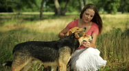 Girl with her dogs smiles at camera Stock Footage