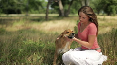 Girl petting her dog Stock Footage
