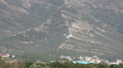Aircraft flight over mount town Stock Footage